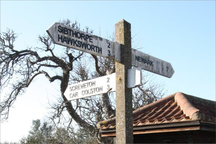 Photo of village sign post